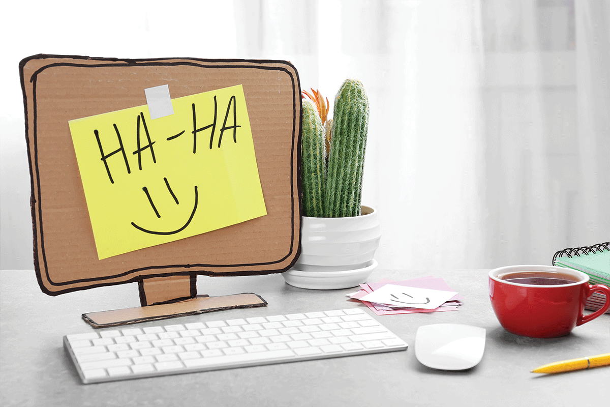 Computer with cardboard monitor on office table, April fool's day celebration | Photo: Adobe Stock