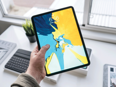 Person holding turned-on black iPad | Photo: Henry Ascroft via Unsplash