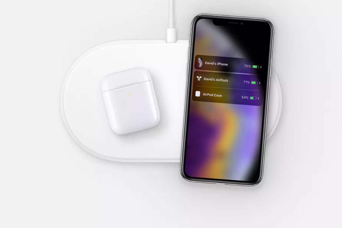 iPhone XS charging next to an AirPods charging case | Photo: The Verge