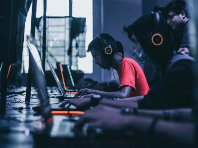 Gamers playing on laptop | Photo: Fredrick Tendong