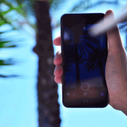 Person holding iPhone in sun | Photo: Marvin Meyer via Unsplash