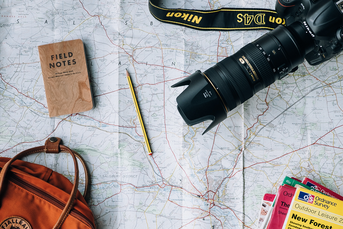 Camera and travel map | Photo: Annie Spratt via Unsplash