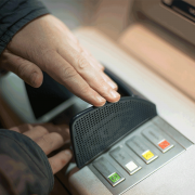 Person entering pin into ATM/cash machine | Photo: mrganso via Pixabay