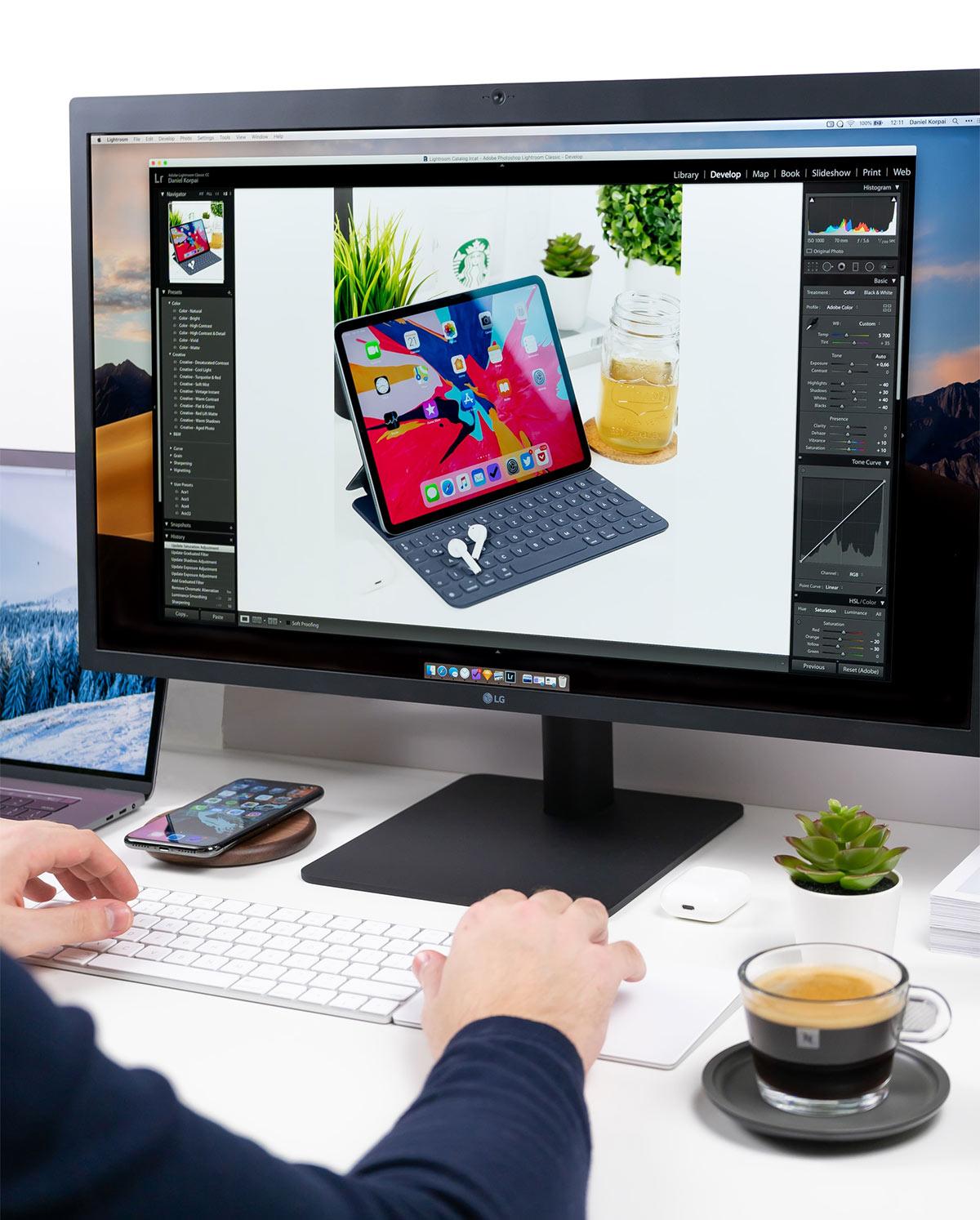 Person editing photo on Adobe Lightroom on desktop | Photo: Danoel Korpai via Unsplash