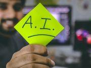 Person holding green paper with AI written on | Photo: Hitesh Choudhary via Unsplash