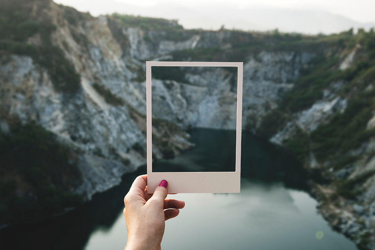 Person holding polaroid in front of view | Photo: CEWE Photoworld