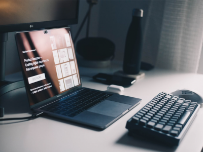 Laptop setup on desk with keyboard and mouse | Photo: Med Badr Chemmaoui via Unsplash