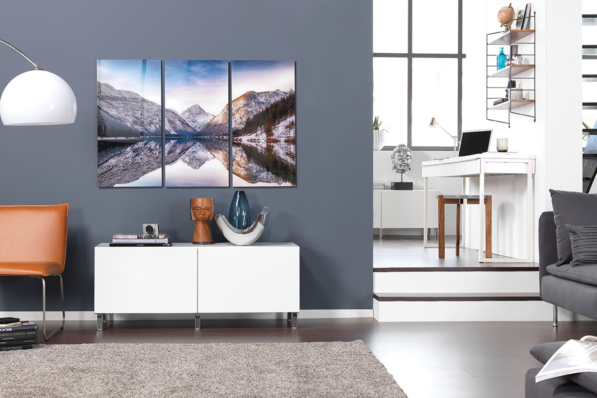 Photo tiles on wall in living room | Photo: CEWE Photoworld