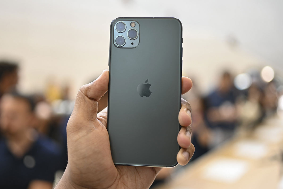Person holding iPhone 11 Pro in hand - space grey | Photo: Digital Trends