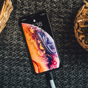 Gold iPhone XS on black textile | Photo: Pascal Brändle via Unsplash