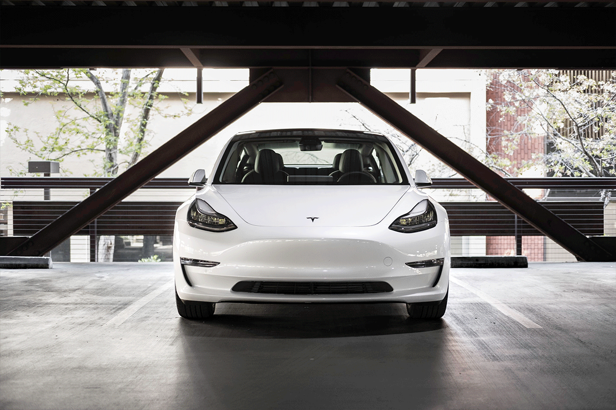 White coupe parked inside garage | Photo: Charlie Deets via Unsplash