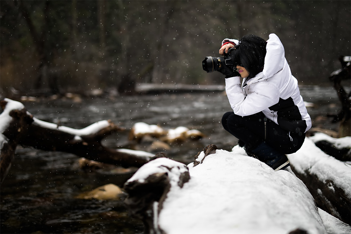 Person holding camera on snow-covered surface | Photo: Sean Pierce via Unsplash