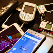 Several old mobile phones, including Android and Nokia | Photo: Eirik Solheim via Unsplash