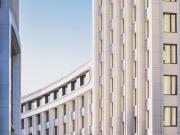 Curved white concrete building   Photo: Mike Kononov via Unsplash