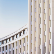 Curved white concrete building | Photo: Mike Kononov via Unsplash