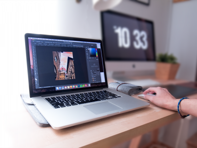Person using MacBook Pro on brown wooden desk | Photo: Domenico Loia via Unsplash