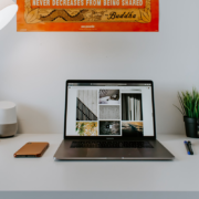 MacBook Pro on desk | Photo: Aditya Chinchure via Unsplash
