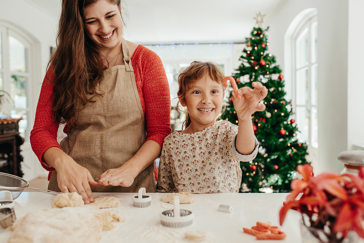 Mother and daughter making Christmas cookies | Photo by Jacob Lund via Shutterstock