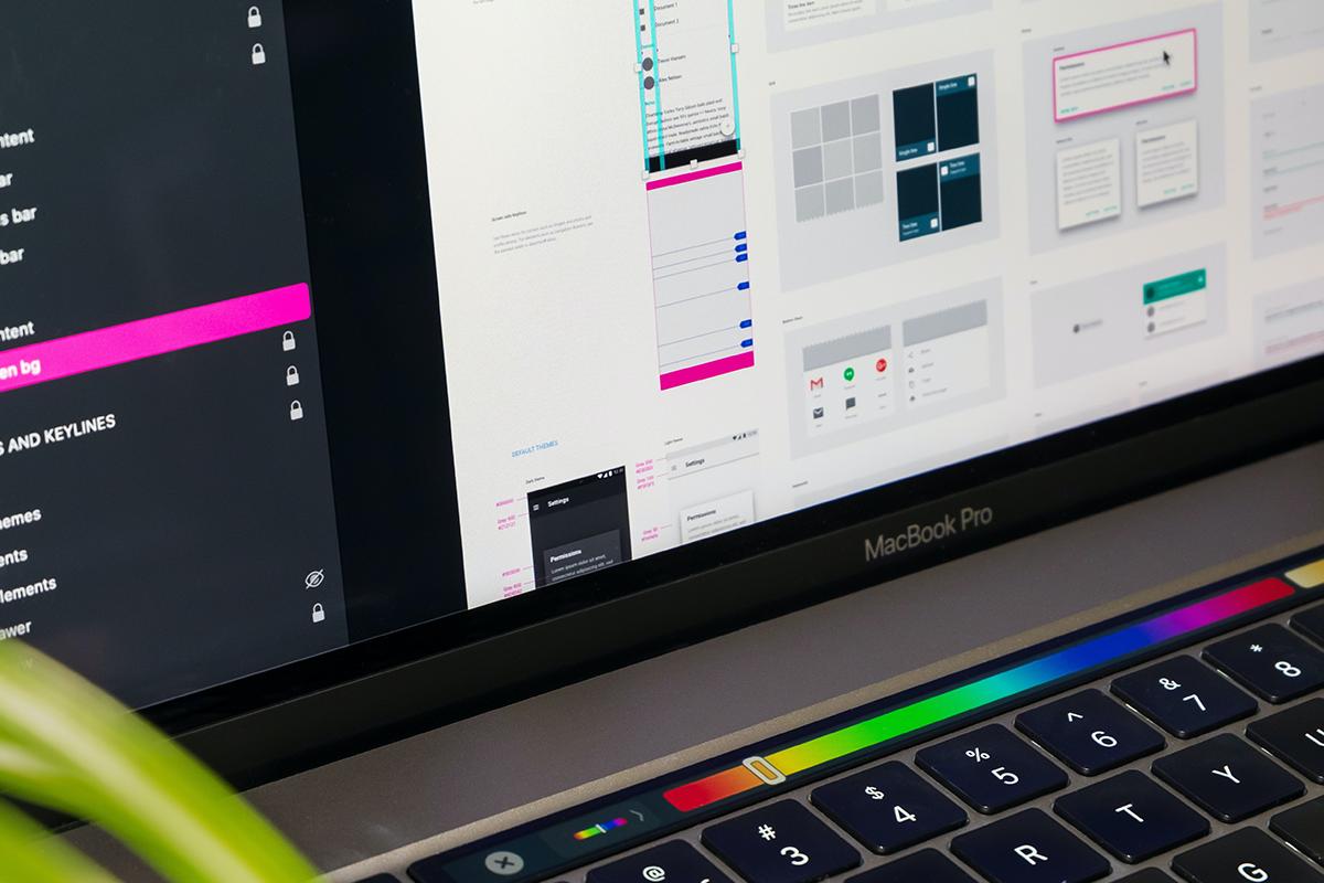 Person using the Touch Bar on MacBook Pro | Photo: Tirza van Dijk via Unsplash